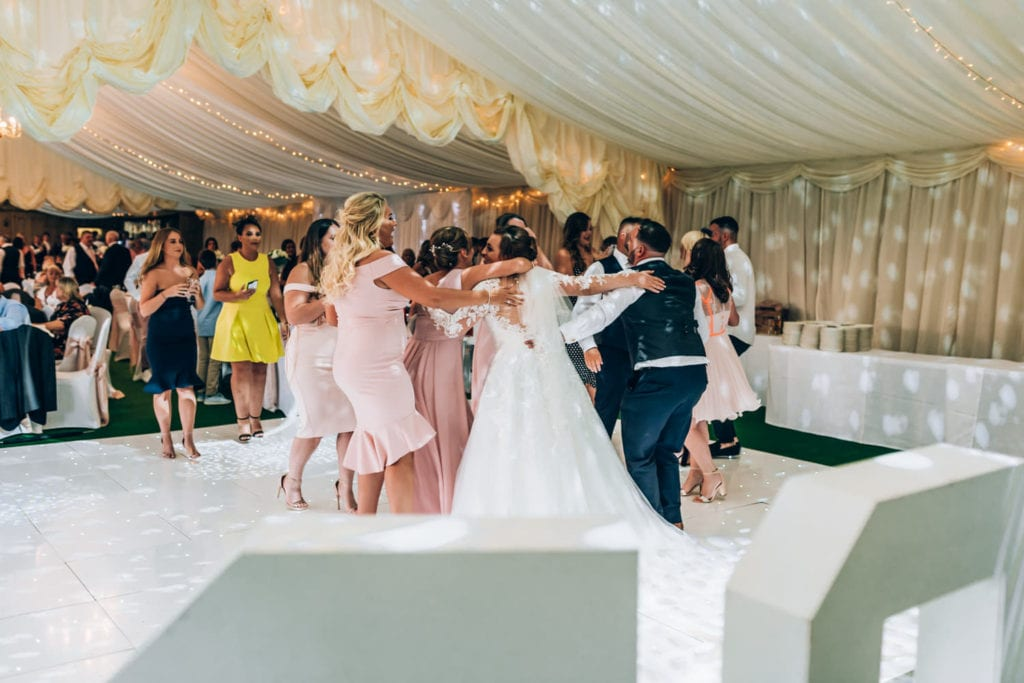 Group of people dancing in marquee wedding - Cottrell Park Golf Resort, South Wales weddings
