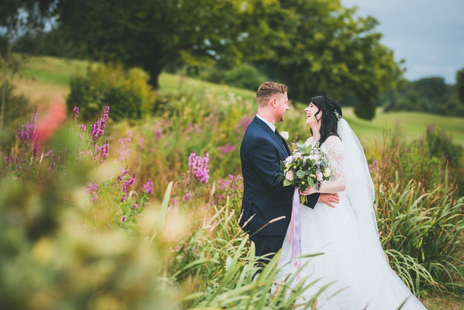 Wedding couple smiling in nature - outdoor wedding - Cottrell Park