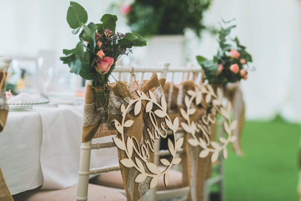 Wedding chair covered in flowers and decor - wedding venue in South Wales, Cottrell Park
