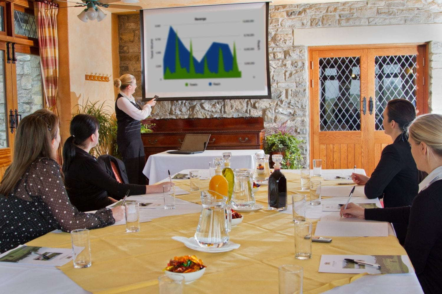 Meeting rooms to hire, South Wales - Group of business people watching a presentation in a cottage stylised conference space
