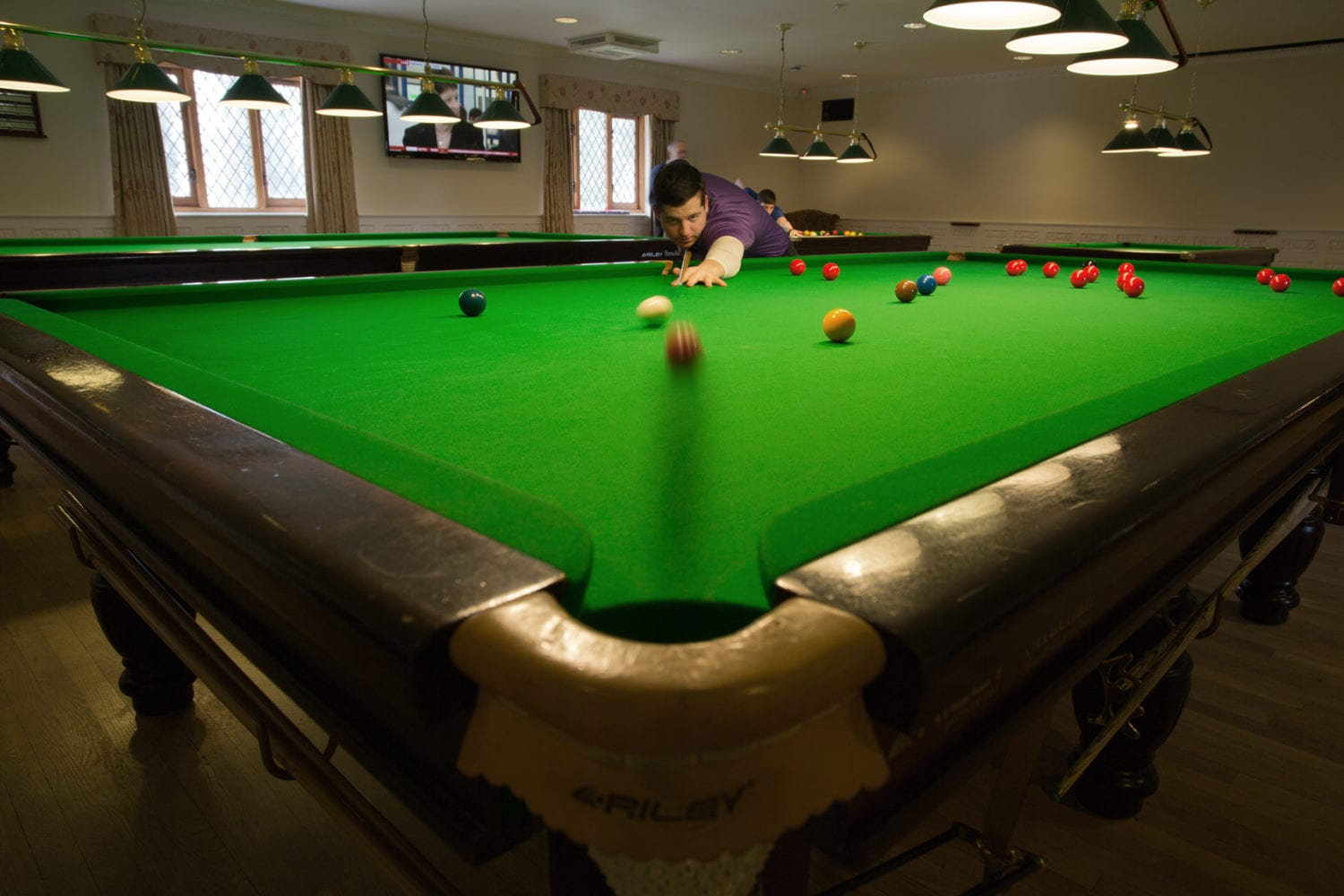 Snooker in South Wales, Pool tables in Cardiff - Man banking a shot on a snooker table