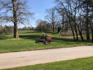 Cottrell Park team member mowing the golf courses